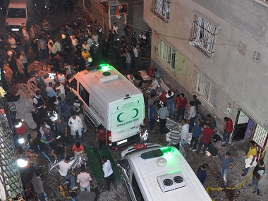 Ambulances at the bombing site in Gaziantep, southeastern Turkey. AP