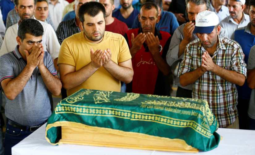 Family members of Sehriban Nurbay, a 3-month-old victim of a suicide bombing at a wedding in Gaziantep, attend her funeral ceremony in Gaziantep. Reuters