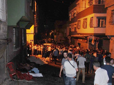 People gather after an explosion in Gaziantep, southeastern Turkey, early Sunday, Aug. 21, 2016. Gaziantep Province Gov. Ali Yerlikaya said the deadly blast, during a wedding near the border with Syria, was a terror attack. (Eyyup Burun/DHA via AP)e