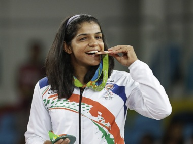India's Sakshi Malik with her bronze medal. AP