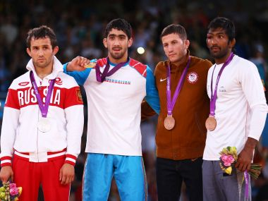 Silver medalist Besik Kudukhov of Russia, Gold medalist Toghrul Asgarov of Azerbaijan, Bronze medalist Coleman Scott of the United States, and Yogeshwar Dutt of India on podium at the 2012 London Olympics. Getty Images