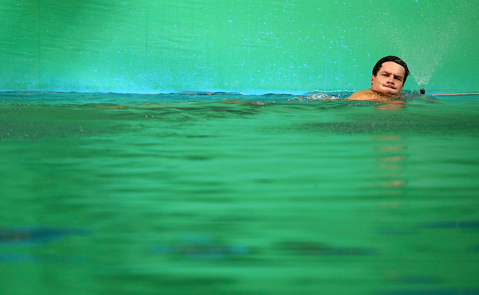 Organisers gave up hopes of cleaning up the adjacent water polo and synchronised swimming pool, which was also affected, and started replacing the cloudy water instead. Patrick Hausding of Germany swims in the green colored water of the diving pool. Reuters