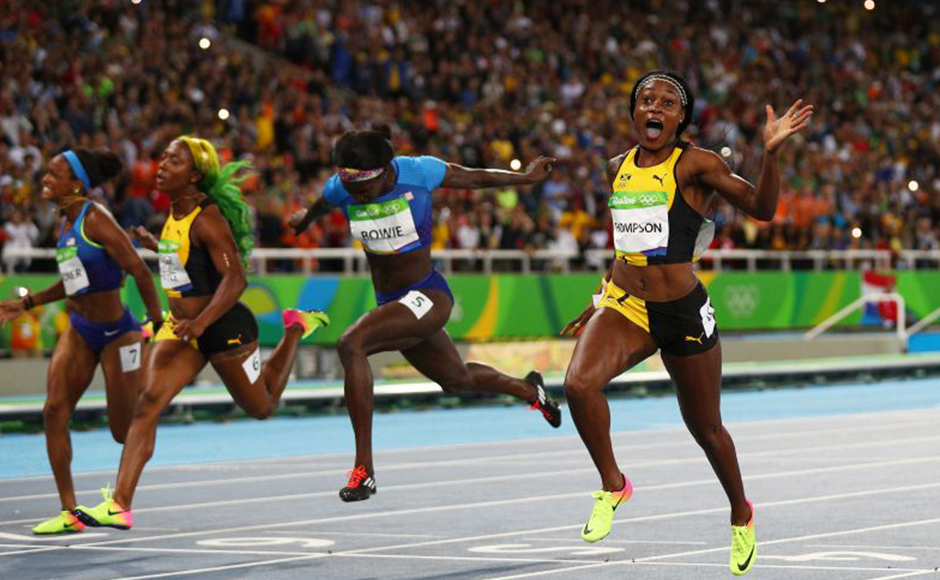 Elaine Thompson celebrates winning the Women's 100m final. Getty Images