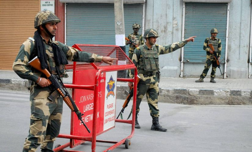 BSF Jawans guard the streets during curfew in Srinagar. PTI