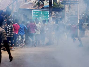 Protesters clash with police in Kashmir. PTI
