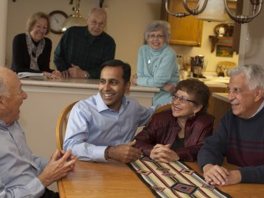 Raja Krishnamoorthi with constituents in a dining room in his district.