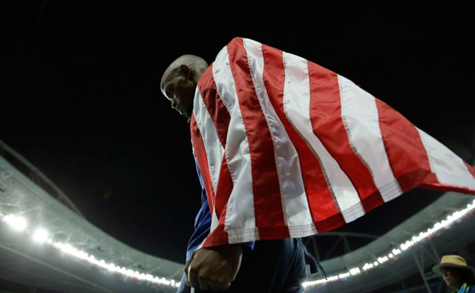 Jeff Henderson celebrates winning the gold medal in the men's long jump. He dedicated the victory to his mother, who has Alzheimer's disease. AP
