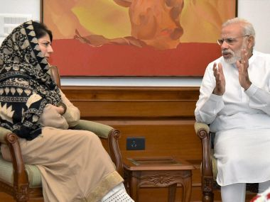 Jammu and Kashmir Chief Minister Mehbooba Mufti with Prime Minister Narendra Modi at 7 RCR in New Delhi on Saturday. PTI