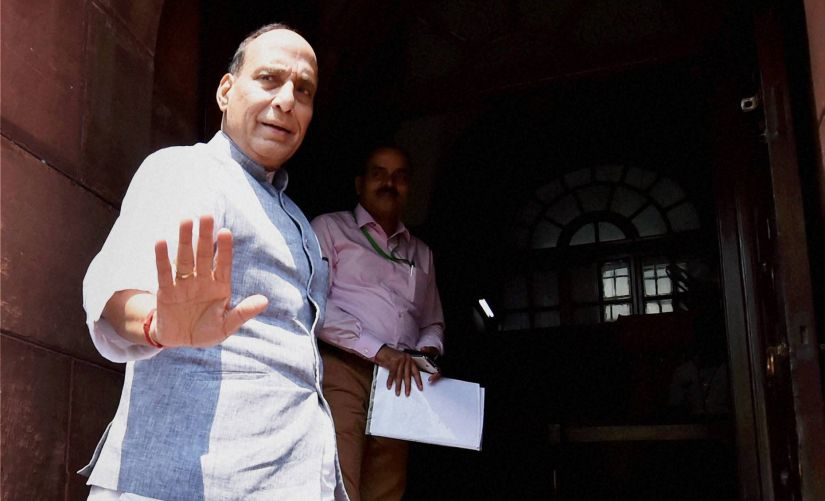 Union Home Minister Rajnath Singh outside the Parliament on Friday. PTI