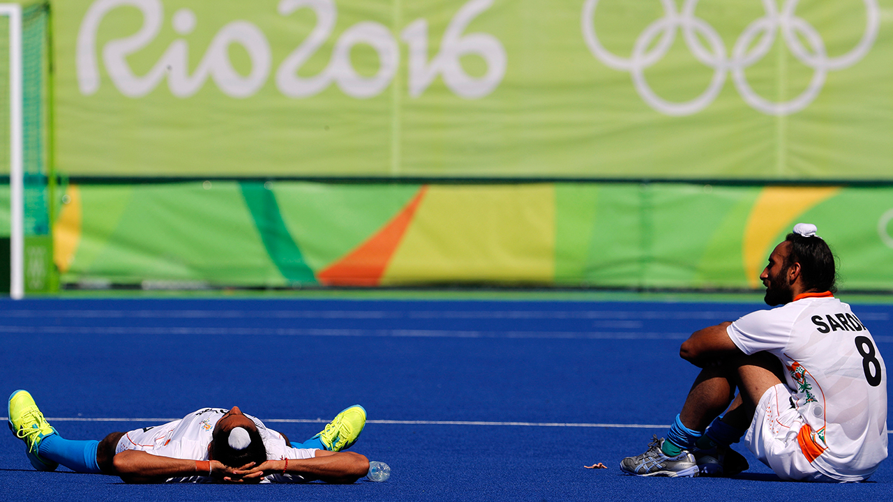 FILE-In this Aug. 14, 2016, file photo, players from India stay in the pitch a little longer after they lost to Belgium during a men's field hockey quarter final match at the 2016 Summer Olympics in Rio de Janeiro, Brazil. Although months ahead of the Rio Games, Indian sports officials vowed that this massive nation, long known for its dismal Olympic results, would be proud of its athletes this year, with just a few days left, India has yet to win even one medal. AP Photo
