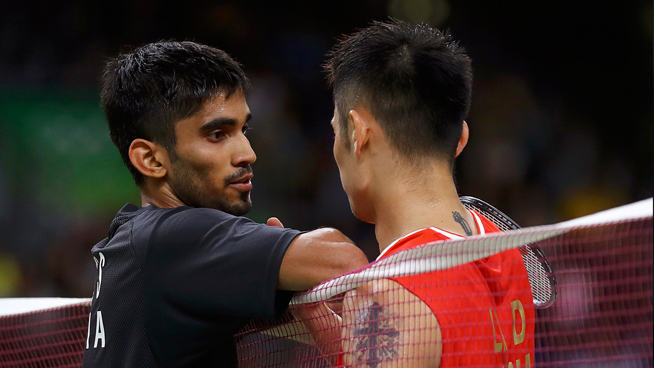 2016 Rio Olympics - Badminton - Men's Singles - Quarterfinals - Riocentro - Pavilion 4 - Rio de Janeiro, Brazil - 17/08/2016. Lin Dan (CHN) of China talks with Srikanth Kidambi (IND) of India over the net after winning their match. REUTERS