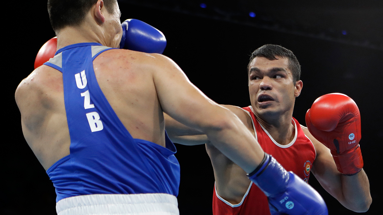 India's Vikas Krishan, right, fights Uzbekistan's Bektemir Melikuziev during a men's middleweight 75-kg quarterfinals boxing match at the 2016 Summer Olympics in Rio de Janeiro, Brazil, Monday, Aug. 15, 2016. AP Photo