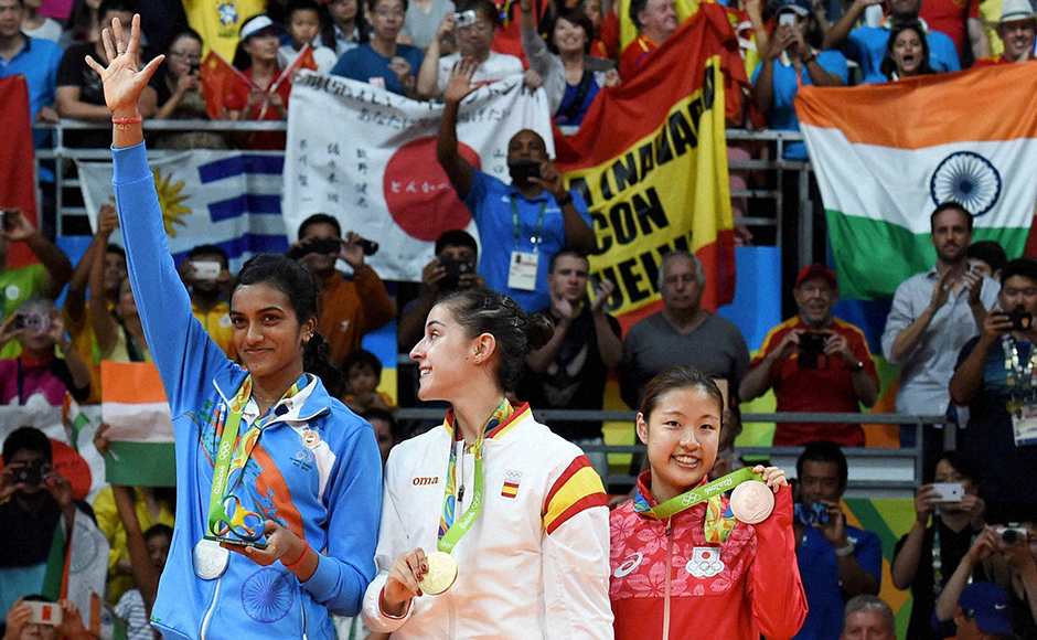 Rio de Janeiro: (L-R) Silver medalist V. Sindhu Pusarla of India, gold medalist Carolina Marin of Spain and bronze medalist Nozomi Okuhara of Japan celebrate during the medal ceremony after the Women's Singles Badminton competition on Day 14 of the Rio 2016 Olympic Games at Rio de Janeiro, Brazil on Friday. PTI Photo by Atul Yadav (PTI8_19_2016_000290B)
