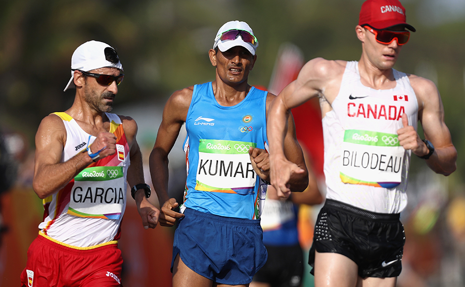 RIO DE JANEIRO, BRAZIL - AUGUST 19: (L-R) A Jesus Garcia of Spain, Sandeep Kumar of India and Mathieu Bilodeau of Canada compete in the Men's 50km Race Walk on Day 14 of the Rio 2016 Olympic Games at Pontal on August 19, 2016 in Rio de Janeiro, Brazil. (Photo by Bryn Lennon/Getty Images)