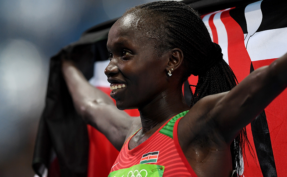 RIO DE JANEIRO, BRAZIL - AUGUST 19: Vivian Jepkemoi Cheruiyot of Kenya celebrates winning the Women's 5000m Final and setting a new Olympic record of 14:26.17 on Day 14 of the Rio 2016 Olympic Games at the Olympic Stadium on August 19, 2016 in Rio de Janeiro, Brazil. (Photo by Quinn Rooney/Getty Images)