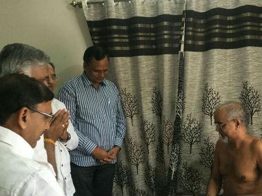 AAP leaders with Jain monk Tarun Sagar. CNN-News18
