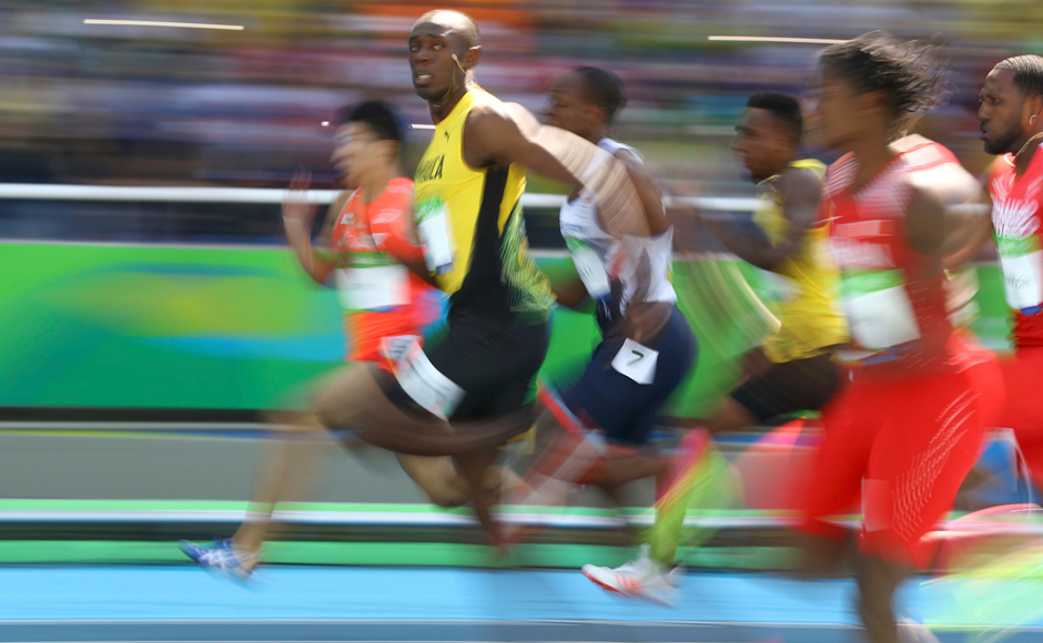 Usain Bolt launched his bid for the 'treble-treble' by cantering through the 100m preliminaries. Reuters