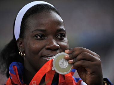 File photo of Cuba's Yarelys Barrios posing on the podium with her silver medal during the women's discus medal ceremony at the 2008 Beijing Olympic Games. AFP