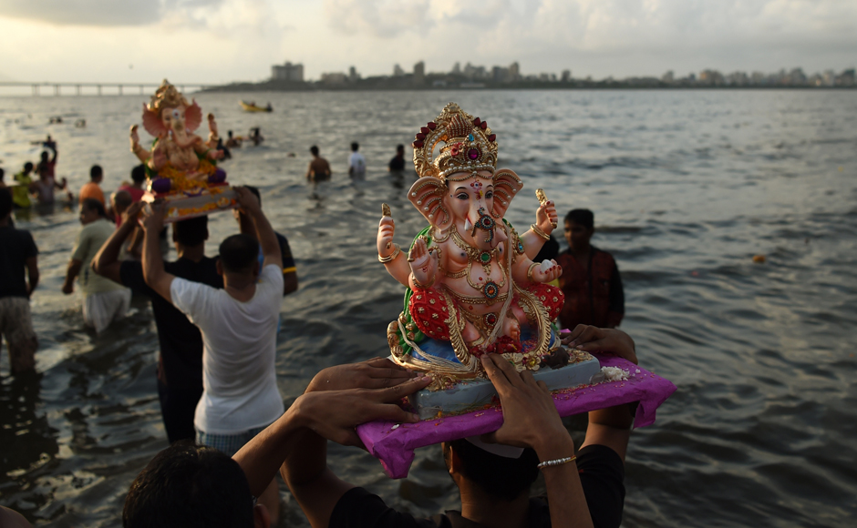 Devotees carry idols of Ganesh for immersion at the Dadar Chowpatty beach on the sixth day of the eleven-day long festival Ganesh Chaturthi in Mumbai on Saturday. The eleventh day sees millions of Hindus gathering along the western city's coast to immerse the elephant-god idols in the Arabian sea. (Photo courtesy: AFP)
