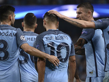 Manchester City's striker Sergio Aguero is congratulated after scoring their third goal. AFP