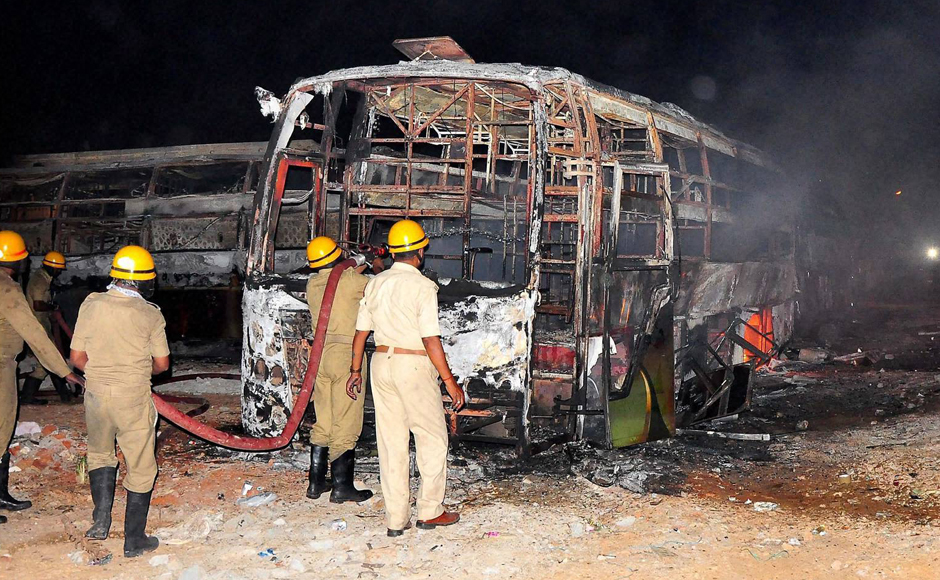 Firefighters trying to douse a fire in Tamil Nadu-bound buses. Managing Director of Salem headquartered KPN Tours and Travels Limited Rajesh Natarajan claimed that 40 of his buses were set on fire. (Photo: PTI)