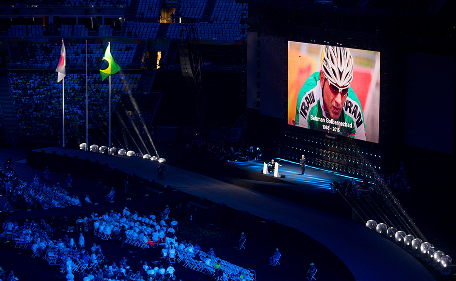Athletes observe a minute of silence in memory of Iran's cyclist Bahman Golbarnezhad who died after crashing in a road race during the Paralympic Games, during the closing ceremony of the Rio 2016 Paralympic Games at the Maracana Stadium in Rio de Janeiro, Brazil, Sunday, Sept. 18, 2016. (AP Photo/Mauro Pimentel)