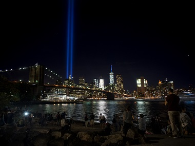 The Tribute in Light, viewed from the Brooklyn borough of New York, rises above the lower Manhattan skyline on Sunday. AP