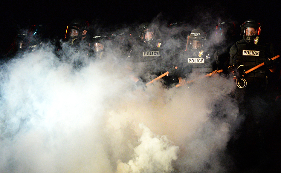 Police stand in formation in Charlotte, N.C., Tuesday, Sept. 20, 2016. Authorities used tear gas to disperse protesters in an overnight demonstration that broke out Tuesday after Keith Lamont Scott was fatally shot by an officer at an apartment complex. AP