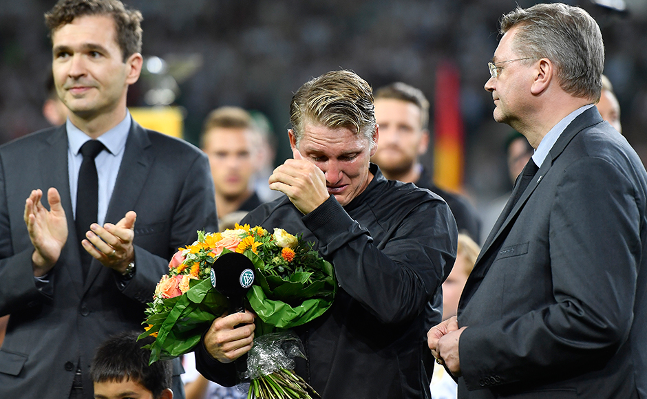 Germany's Bastian Schweinsteiger hides tears during a farewell ceremony prior a friendly soccer match between Germany and Finland in Moenchengladbach, Germany, Wednesday, Aug. 31, 2016. The captain plays his last match for the national team.AP