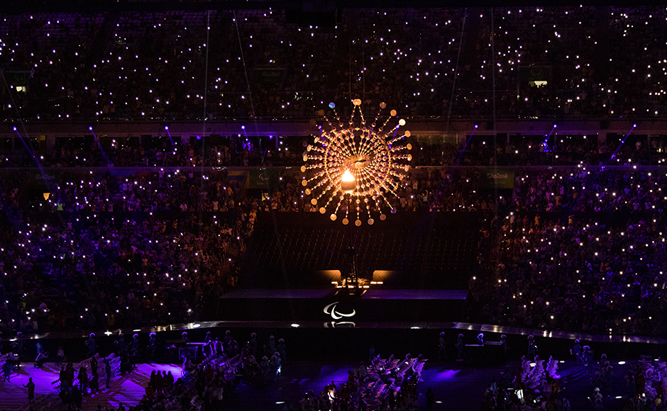 In this photo released by the IOC, the lights of a hundreds of mobile phones shine around the Paralympic Cauldron as it burns for the last few seconds during the closing ceremony of the Rio 2016 Paralympic Games at the Maracan' Stadium in Rio de Janeiro, Brazil , Sunday, Sept. 18, 2016. (Al Tielemans/OIS, IOC via AP)