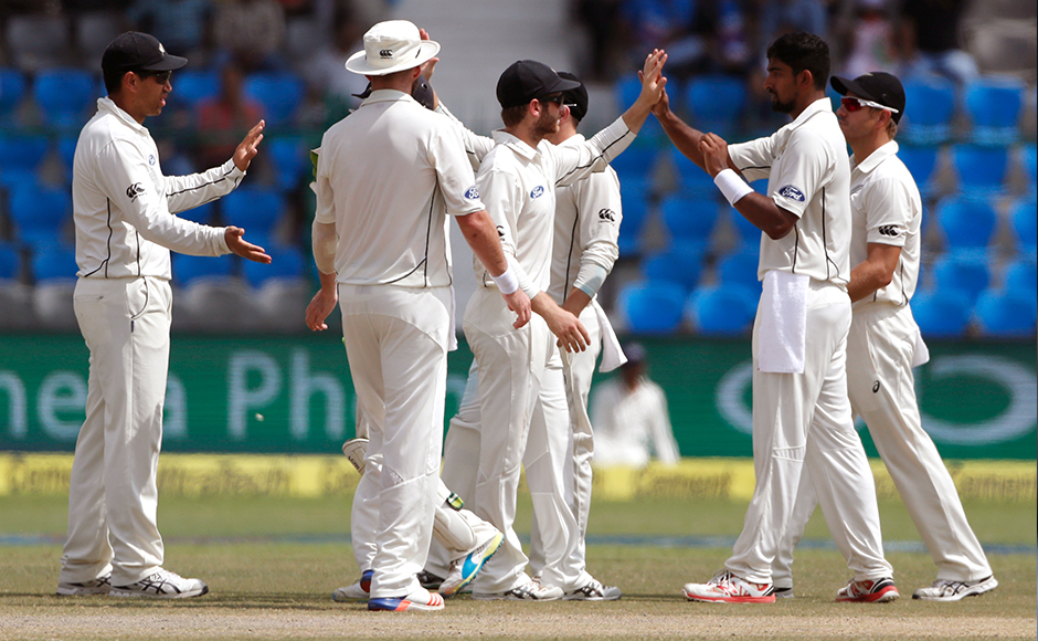 New Zealand's Ish Sodhi, second right, and his team celebrates the wicket of India's Cheteshwar Pujara on the fourth day of their first cricket test match at Green Park Stadium in Kanpur, India, Sunday, Sept. 25, 2016. (AP Photo/ Tsering Topgyal)