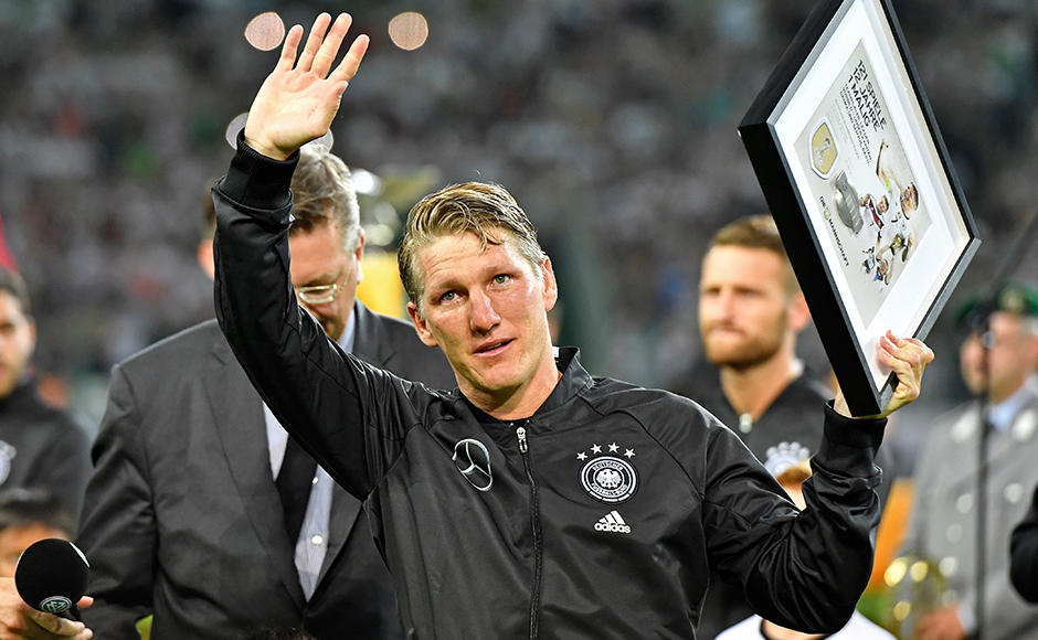 Germany's Bastian Schweinsteiger waves to supporters during a farewell ceremony prior a friendly soccer match between Germany and Finland in Moenchengladbach, Germany, Wednesday, Aug. 31, 2016. The captain plays his last match for the national team.AP