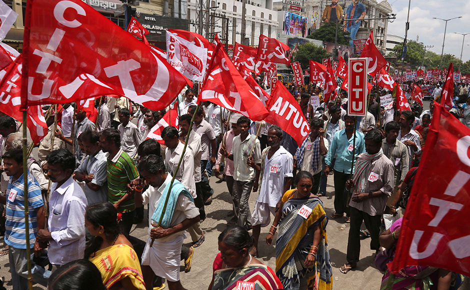 Indian workers participate in a rally during a nationwide strike called by trade unions in Hyderabad, India, Friday, Sept. 2, 2016. The strike has been called against government's alleged anti labor policies. Activists also demanded higher minimum wages and provision of social security for workers from unorganized sectors. AP