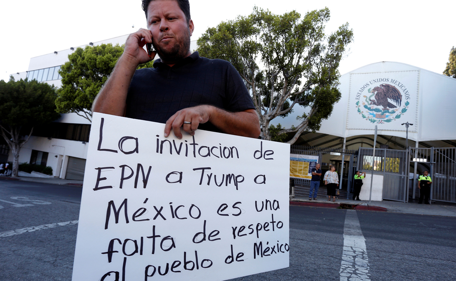 Raul Murillo attends a rally in front of the Mexican Consulate to protest Donald Trump's visit to Mexico in Los Angeles, California. REUTERS