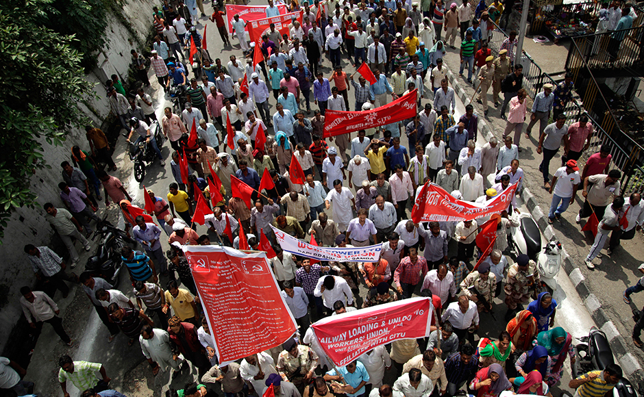 Indian workers participate in a rally during a nationwide strike called by trade unions, in Jammu, India, Sept. 2, 2016.The strike has been called against the government's alleged anti labor policies. Activists also demanded higher minimum wages and provision of social security for workers from unorganized sectors. AP