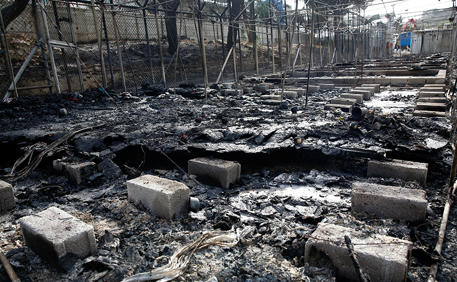 The remains of a burned tent at the Moria migrant camp. Thousands of people fled the camp on the Greek island of Lesbos after fire swept through tents and cabins during violence among residents. Reuters