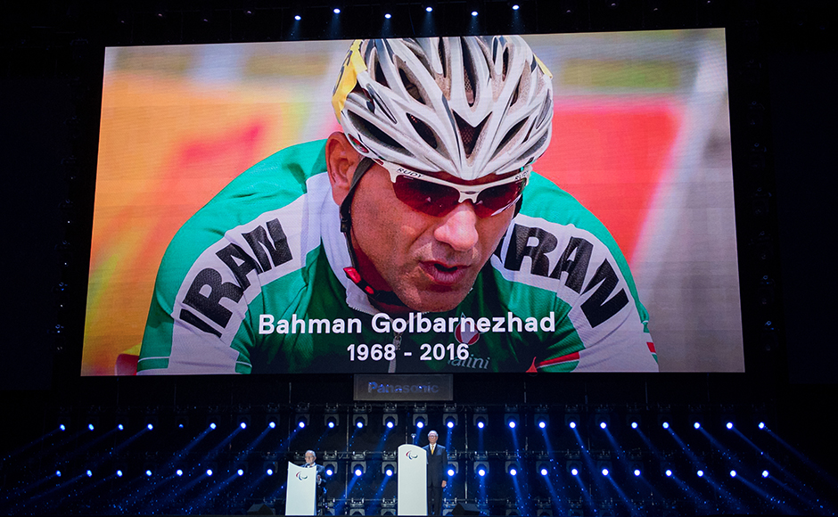In this photo released by the IOC, President of the International Paralympic Committee Sir Philip Craven, left, and President of the Rio 2016 Organizing Committee Carlos Nuzman stand during a moment of silence in honor of Bahman Golbarnezhad IRI who passed away following a crash during the C4 Cycling Road Race at the Rio 2016 Paralympic Games, during the closing ceremony of the Rio 2016 Paralympic Games at the Maracan' Stadium in Rio de Janeiro, Brazil , Sunday, Sept. 18, 2016. (Thomas Lovelock/OIS, IOC via AP)