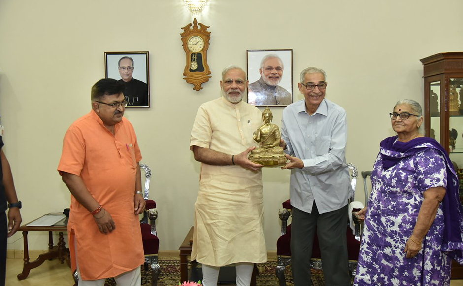 Governor of Gujarat O P Kohli greets PM Moid on his birthday. President Pranab Mukherjee, Vice President Hamid Ansari, Congress leader Rahul Gandhi and a host of other national and foreign leaders wished the prime minister on Saturday. PTI