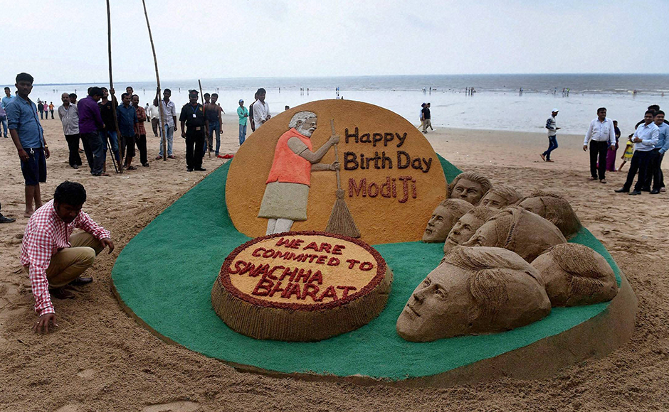 Sand artist Sudarsan Pattnaik creates a sand sculpture in Mumbai wishing PM Modi on his birthday. PM Modi, who was born on 17 September, 1950 in Vadnagar area of Gujarat, began his day by meeting his 97-year-old mother in Gandhinagar. PTI