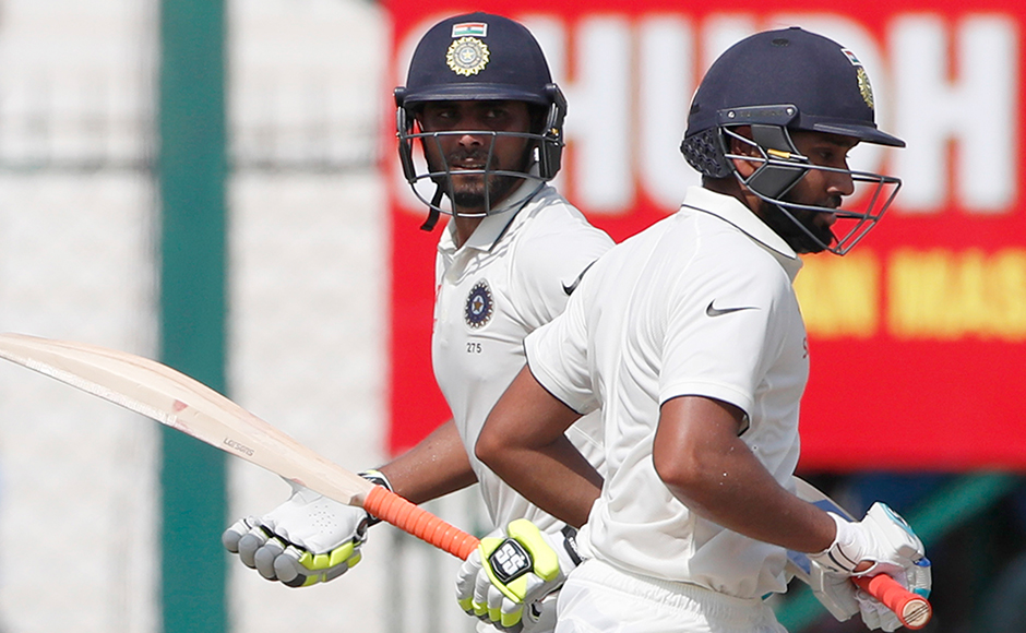 India's Ravindra Jadeja, left, and Rohit runs between the wicket on the fourth day of their first cricket test match against New Zealand at Green Park Stadium in Kanpur, India, Sunday, Sept. 25, 2016. (AP Photo/ Tsering Topgyal)