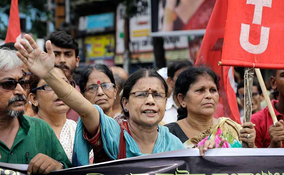Activists of Communist Party of India-Marxist shout slogans during a nationwide strike, in Kolkata, India, Friday, Sept. 2, 2016. The strike was called against allegedly government's anti labor policies. Activists also demanded higher minimum wages and provision of social security to unorganized workers.AP