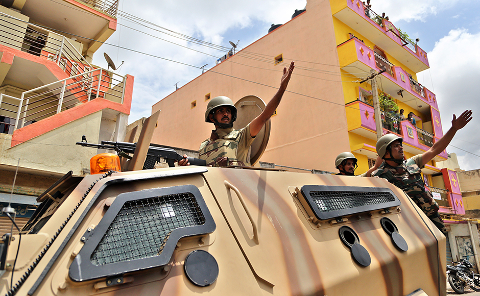 Curfew was relaxed since Tuesday morning for Muslims to offer Eid prayers at mosques and Idgah maidan in 16 sensitive localities where it was imposed on Monday night after violence and arson rocked the city over reported attacks on Kannadigas and their property in Chennai on Monday. (Photo: AP)