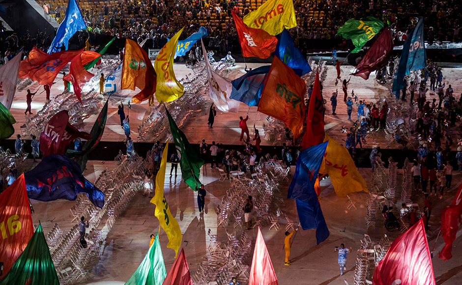 Performers wave flags during the closing ceremony of the Rio 2016 Paralympic Games at the Maracana Stadium in Rio de Janeiro, Brazil, Sunday, Sept. 18, 2016. (AP Photo/Mauro Pimentel)