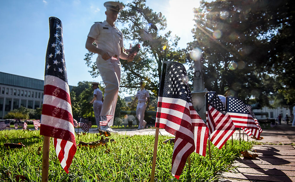 Midshipmen place 2,996 mini American flags on Stribling walk, to represent those lost on 9-11, at the U.S. Naval Academy in Annapolis. Getty Images