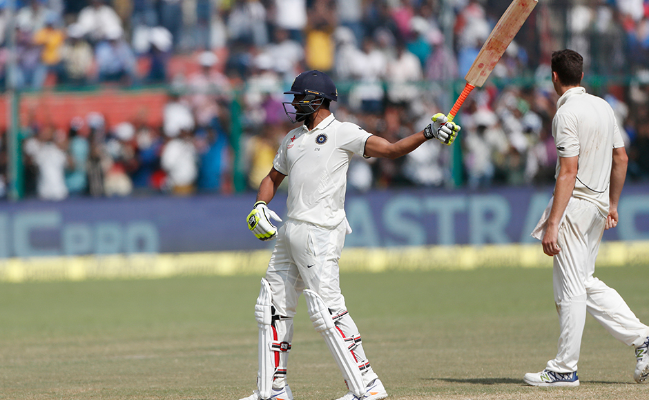 India's Ravindra Jadeja raises bat after scoring fifty runs on the fourth day of their first cricket test match against New Zealand at Green Park Stadium in Kanpur, India, Sunday, Sept. 25, 2016. (AP Photo/ Tsering Topgyal)