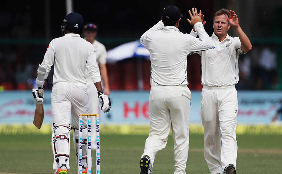 New Zealand's Neil Wagner celebrates a adismissal of India's Umesh Yadav during the second day of their cricket test match at Green Park stadium in Kanpur, India, Friday, Sept. 23, 2016. (AP Photo/Tsering Topgyal)