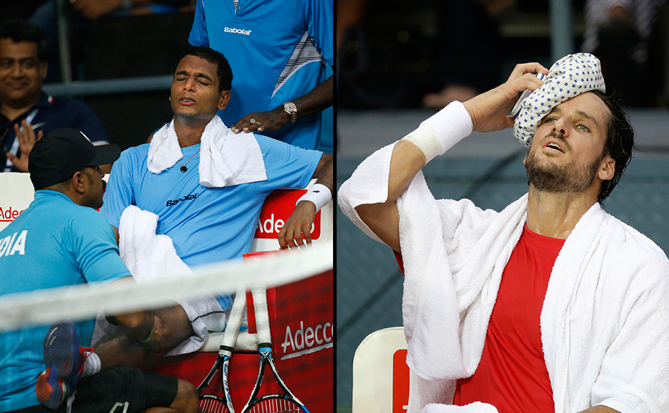 A physiotherapist attends to India's Ramkumar Ramanathan during his Davis Cup men's tie against Spain's Feliciano Lopez in New Delhi, India, Friday, Sept. 16, 2016. (AP Photo/Saurabh Das) Spain's Feliciano Lopez takes a break between sets in his Davis Cup men's tie against India's Ramkumar Ramanathan in New Delhi, India, Friday, Sept. 16, 2016. (AP Photo/Saurabh Das)