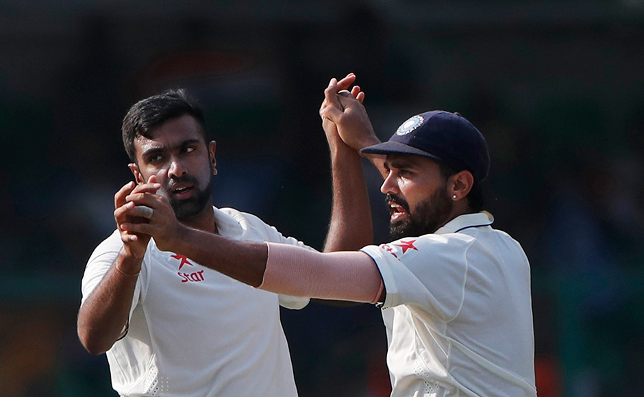 India's Ravichandran Ashwin,left, and Murali Vijay celebrates wicket of New Zealand's Kane Williamson on the fourth day of their first cricket test match at Green Park Stadium in Kanpur, India, Sunday, Sept. 25, 2016. (AP Photo/ Tsering Topgyal)