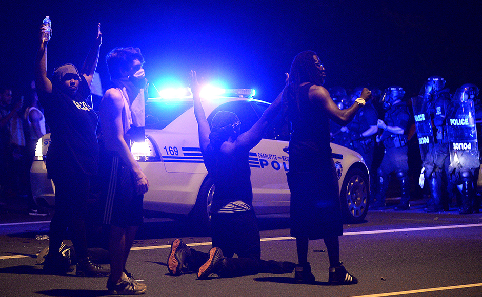 Protesters demonstrate in front of police in Charlotte, N.C., Wednesday, Sept. 21, 2016. Authorities used tear gas to disperse protesters in an overnight demonstration that broke out Tuesday after Keith Lamont Scott was fatally shot by an officer at an apartment complex.AP