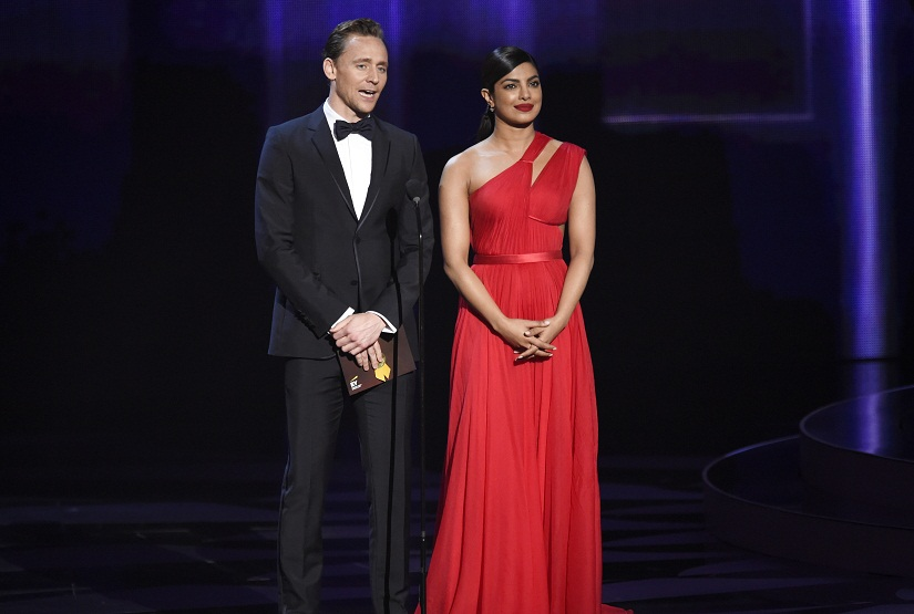 Tom Hiddleston, left, and Priyanka Chopra appear on stage at the 68th Primetime Emmy Awards on Sunday, Sept. 18, 2016, at the Microsoft Theater in Los Angeles. (Photo by Chris Pizzello/Invision/AP)